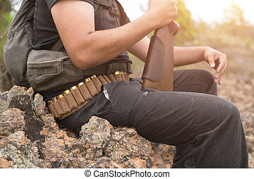 Close up view of an unrecognizable hunter with a shotgun.