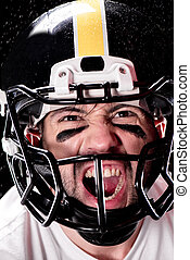 angry man american football player in helmet looking at camera