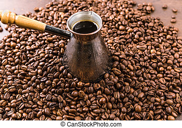 close up view of aromatic coffee beans and turk with coffee