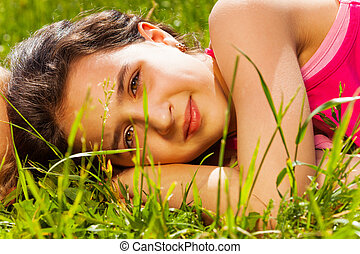 Close up view of beautiful girl on green grass