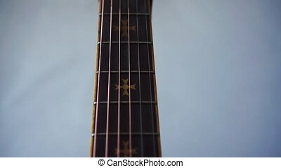 Close up view of black acoustic guitar. - Close up view of...