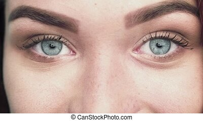 Close up view of blue woman eyes with beautiful golden shades