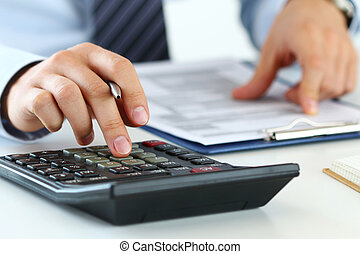Close up view of bookkeeper or financial inspector hands ...