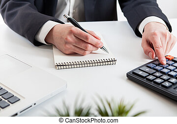 Close up view of bookkeeper or financial inspector hands...