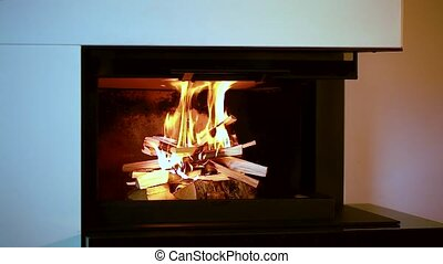 Close up view of burning wood in fireplace. Beautiful backgrounds.