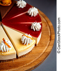 close up view of cheesecake sliced on a wooden plate