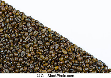 Close-up view of coffee beans surface isolated on white background with place for text