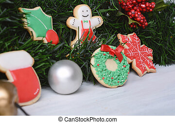 Close up view of colorful Christmas cookies with festive decoration.