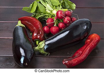 Close up view of colorful vegetables on brown wooden background isolated. Healthy food concept.