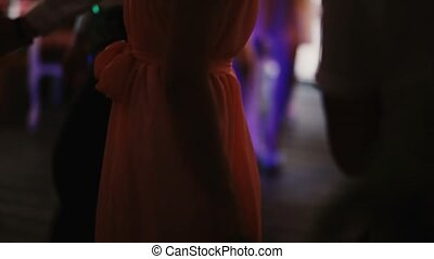 Close-up view of crowd dancing at night club. Group of people in dress and costumes have fun. Prom ball of students.
