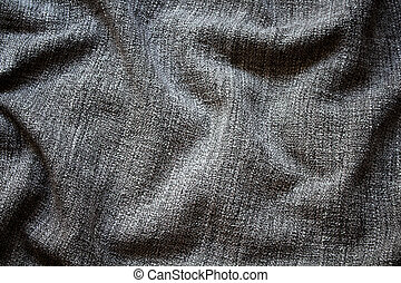 Close up view of crumpled, grey wool fabric background.