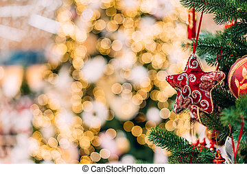 close up view of decorative toys on christmas tree