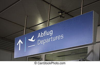 Close up view of Departures sign at airport.
