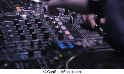 Close Up View of Disc Jockey Hands Mixing Music on His Deck...