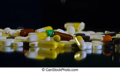Close-up view of drug tablets and pills falling from above....