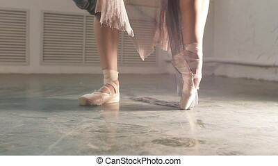 Close up view of elegant ballerina standing on toes in...