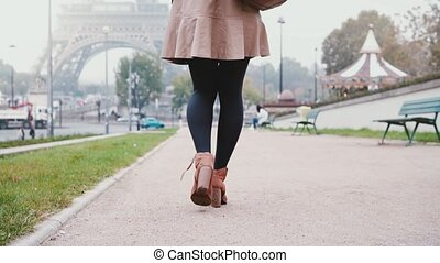 Close-up view of female foot. Young stylish woman walking...