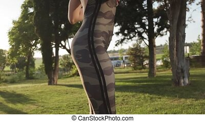 Close up view of female sporty butt during running at park...