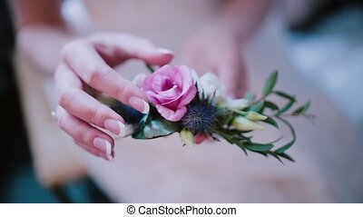 Close-up view of florist woman holding the flower...