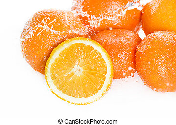 Close-up view of fresh ripe oranges with water drops isolated on white, fresh fruits falling in water splash