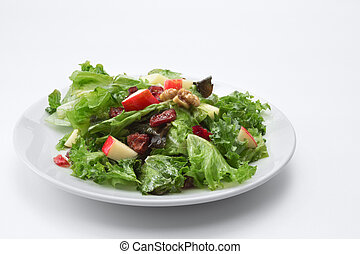 close up view of fresh vegetable salad on white background