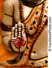 view of Hand of Indian god shiva idol ,in blessing pose