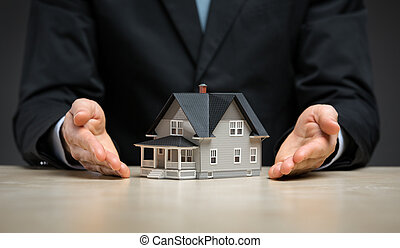 Close up view of hands with little house