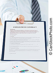 Close up view of human resources manager offering employment contract
