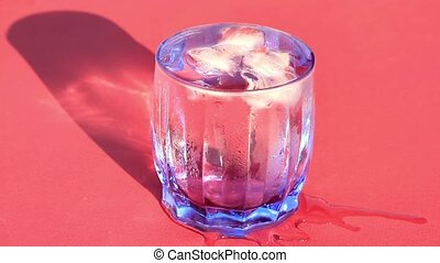 Close up view of ice pieces in wate - Glass of cold water...