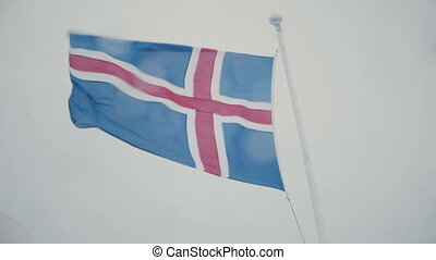 Close-up view of icelandic flag on flagpole on the board of...