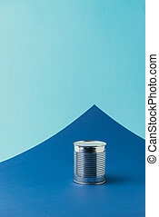 close up view of metal can on blue background, recycle concept