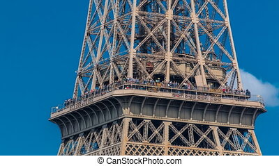 Close up view of middle section of the Eiffel Tower timelapse in Paris, France.