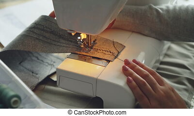 Close-up view of modern electric sewing machine working...