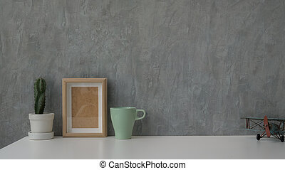 Close up view of modern workspace on white table with grey loft wall