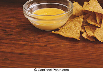 Close up view of nachos with cheese dip