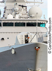 Close-up view of naval ship with gun.