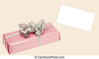 Close up view of pink present box on background. Holidays concept.