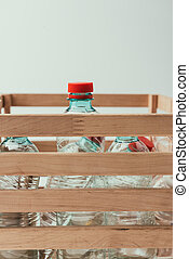 close up view of plastic bottles in wooden box, recycling concept