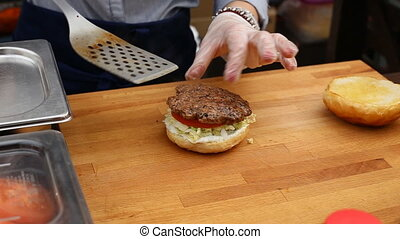 Close up view of preparing a delicious hamburger