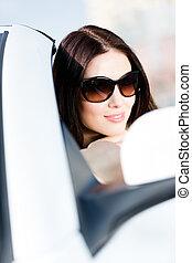 Close-up view of pretty female driver