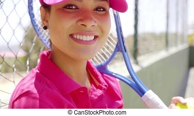 Close up view of pretty tennis player wearing pink
