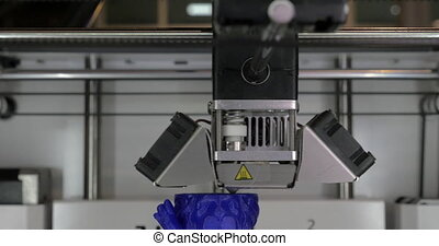 Close up view of printing plastic model on a 3D printer in process.