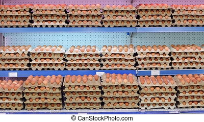 Close-up view of raw chicken eggs in egg boxes. Raw eggs for sale.