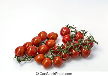 Close up view of red cherry tomatoes isolated on white background. Healthy food concept.