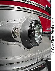 Close-up view of retro bus headlight.