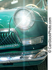 Close-up view of retro car headlight.