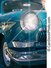 Close-up view of retro car headlight.