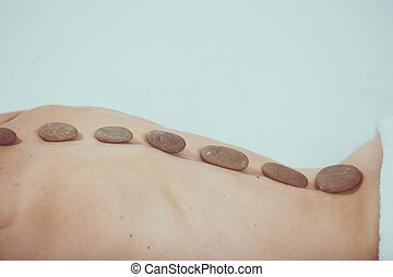 Hot stone massage therapy at beauty center