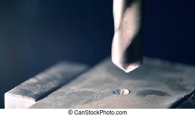 Spinning Metal Spiral Drill - Close-up View of Spinning...