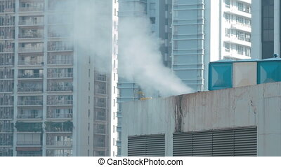 close up view of steam on the roof in the city - steam on...